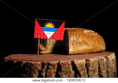 Antigua And Barbuda Flag On A Stump With Bread Isolated
