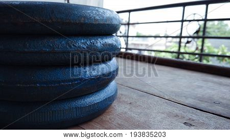 closeup up gym dabble plates on wood background