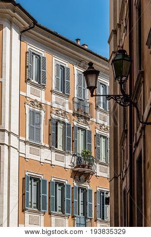 Rome Italy - August 18 2016: Low angle view of old buildings in historical centre of Rome a sunny summer day. Piazza di Pietra near Adrian Temple