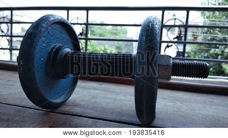 closeup gym dabble with plates on wood background