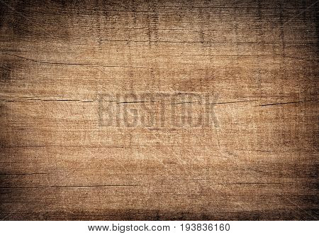 Brown dark scratched wooden cutting, chopping board. Wood texture