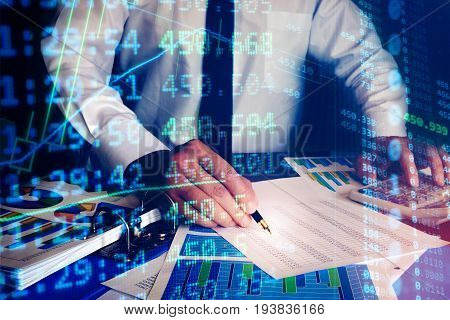 Trader checking data in an office. Trading concept.
