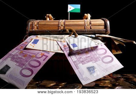 Djibouti Flag On Top Of Crate Full Of Money