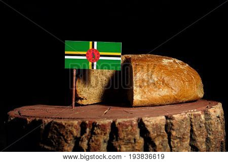 Dominica Flag On A Stump With Bread Isolated