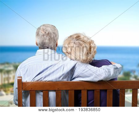 Senior couple senior adult retirement grandparent mature couple bench heterosexual couple