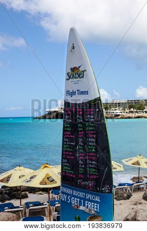 ST. MAARTEN - AUGUST 1:  Maho Bay Beach view with Fligh Times board from Sunset Bar and Grill seen in St.Martin/St.Maarten on August 1, 2015
