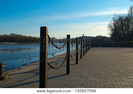 A chain fencing on the river bank