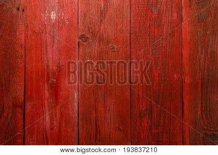 Photo of red wooden texture, board vertically