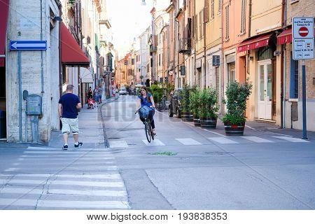 Ferrara, Italy - June, 30, 2017: pedestrian cross on a street in a center of Ferrara, Italy