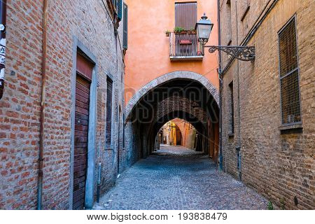 Ferrara, Italy - June, 30, 2017: district of a medieval houses in a center of Ferrara, Italy