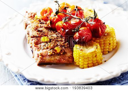Grilled Pork Ribs  with Cherry Tomatoes and Sweetcorn