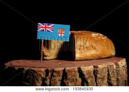 Fijian Flag On A Stump With Bread Isolated