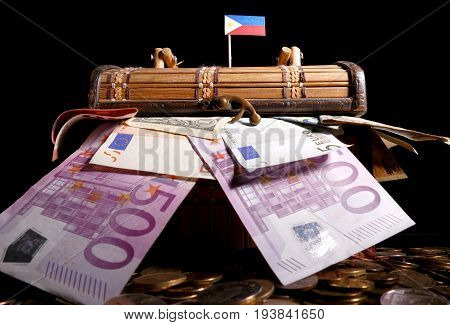Philippines Flag On Top Of Crate Full Of Money