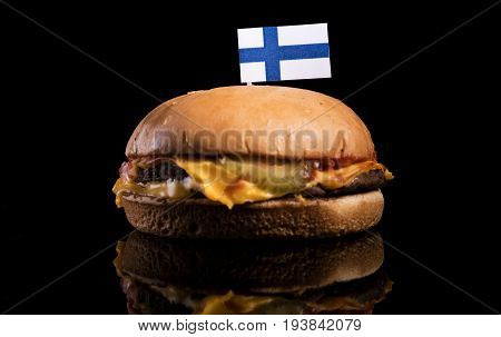 Finnish Flag On Top Of Hamburger Isolated On Black Background