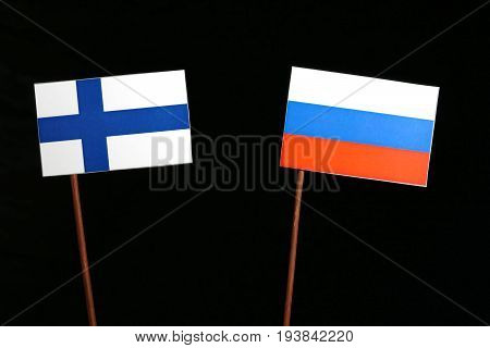 Finnish Flag With Russian Flag Isolated On Black Background