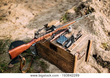Old Soviet Russian Disassembled Sks Semi-automatic Carbine On A Wooden Box. Weapon Of Red Army In World War II.