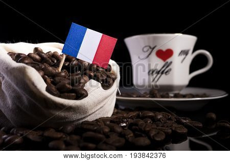 French Flag In A Bag With Coffee Beans Isolated On Black Background