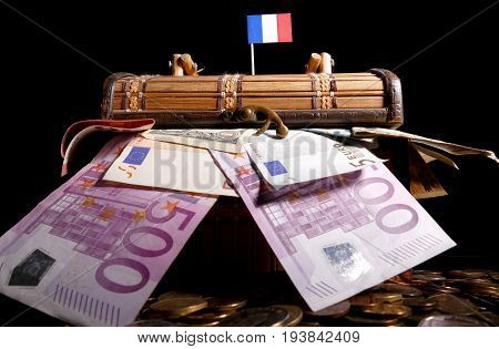 French Flag On Top Of Crate Full Of Money