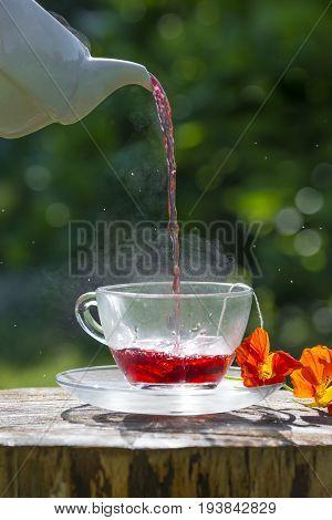 a fruity tea on the garden table