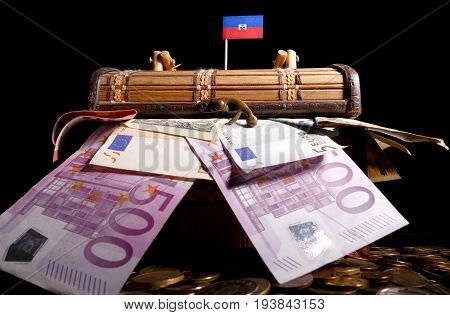Haitian Flag On Top Of Crate Full Of Money