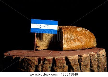 Honduras Flag On A Stump With Bread Isolated