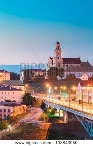 Grodno, Belarus - June 9, 2017: Catholic Church Of The Discovery Of The Holy Cross And Bernardine Monastery At Evening In Night Illuminations Lights. Blue Hour In Hrodna. Sunset Sky