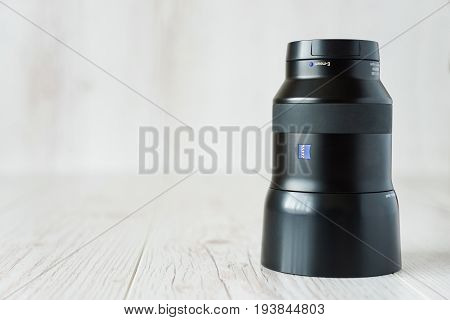 Moscow Russia - July 4 2017: Camera lens Zeiss Batis 85mm for E-mount mirrorless