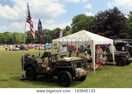 Sandhurst, Uk - June 18 2017: 1943 Ww2 Us Army Willys Jeep At A Car Show With Enthusiasts In Backgro