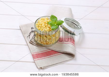 jar of small pasta shells on folded place mat