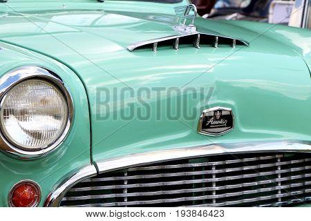 Sandhurst, Uk - June 18 2017: Front Of A 1958 Austin A55 Mk1 Cambridge In Palm Green Showing Bonnet,