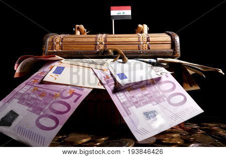 Iraqi Flag On Top Of Crate Full Of Money