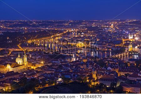 Prague at twilight blue hour view of Charles Bridge on Vltava with Mala Strana Old Town and Prague castle.