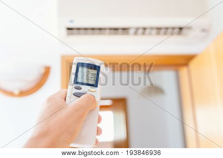 Close Up On Male Hand Adjusting Home Air Condition