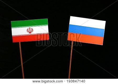 Iranian Flag With Russian Flag Isolated On Black Background