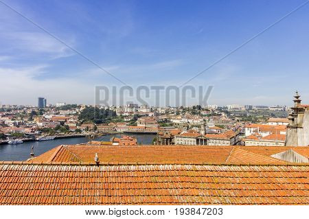 Porto landscape view over Douro River and tradicional rooftops on a summer day Portugal.
