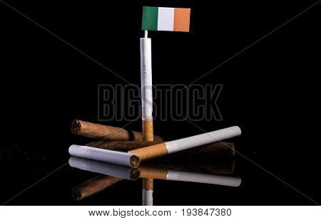 Irish Flag With Cigarettes And Cigars. Tobacco Industry Concept.