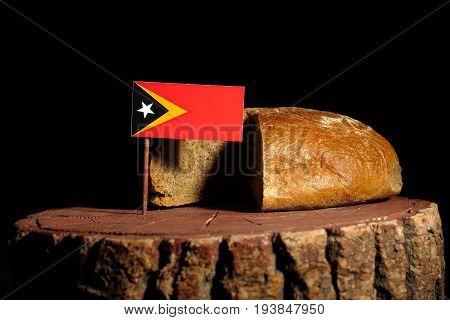 East Timorese Flag On A Stump With Bread Isolated