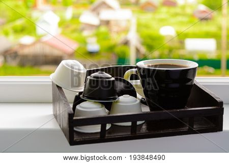 Window With Wooden Tray With Cup Of Black Coffee And Capsules For Coffee Machine