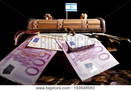 Israeli Flag On Top Of Crate Full Of Money