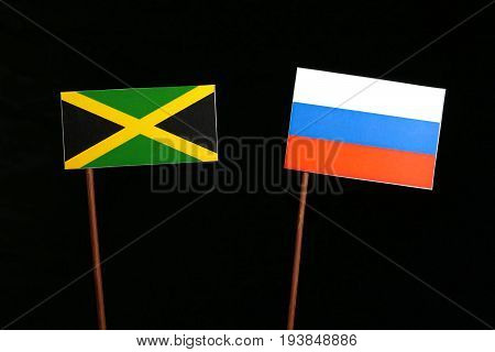 Jamaican Flag With Russian Flag Isolated On Black Background