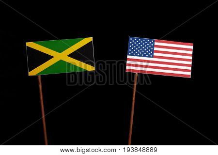 Jamaican Flag With Usa Flag Isolated On Black Background