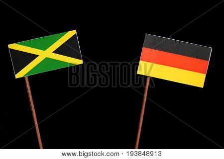 Jamaican Flag With German Flag Isolated On Black Background