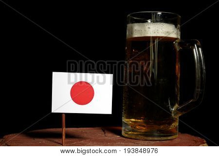 Japanese Flag With Beer Mug Isolated On Black Background