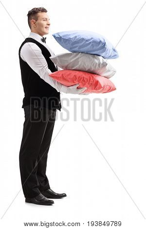 Full length profile shot of a butler with pillows isolated on white background