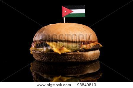 Jordanian Flag On Top Of Hamburger Isolated On Black Background