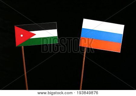 Jordanian Flag With Russian Flag Isolated On Black Background