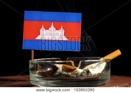 Cambodian Flag With Burning Cigarette In Ashtray Isolated On Black Background