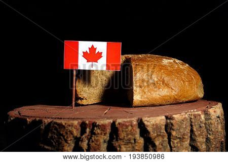 Canadian Flag On A Stump With Bread Isolated