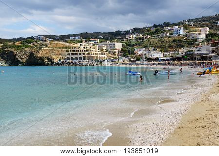 CRETE GREECE - MAY 16: The tourists enjoiying their vacation on the beach on May 16 2014 in Crete Greece. Up to 16 mln tourists is expected to visit Greece in year 2014.