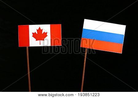 Canadian Flag With Russian Flag Isolated On Black Background